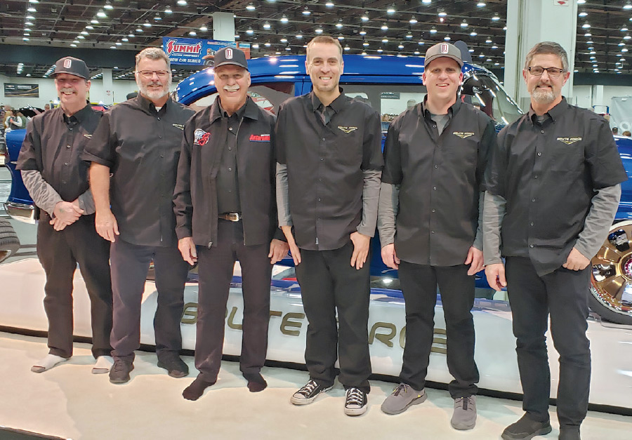 1955 CHEVY restoration team standing side by side in factory