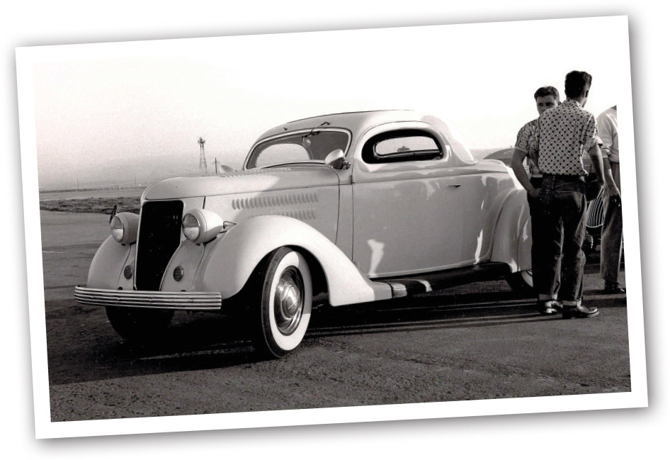polaroid of the 1936 Coupe and men standing by it