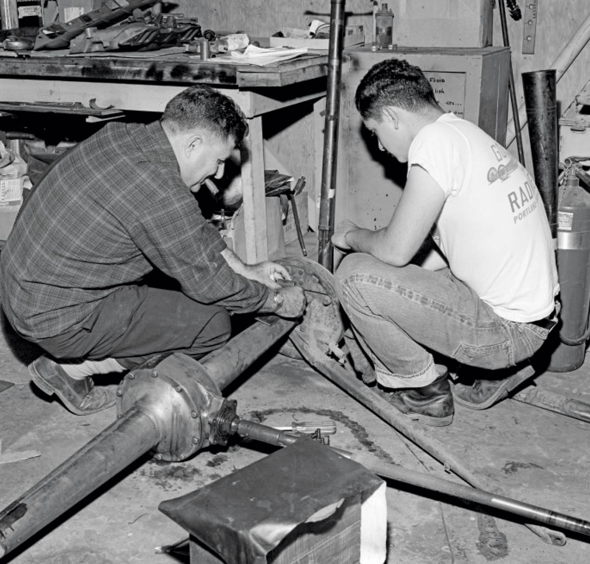 Hot rodders working on car